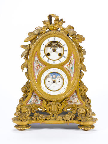 A late 19th century French ormolu mantel clock with perpetual calendar and moonphase
