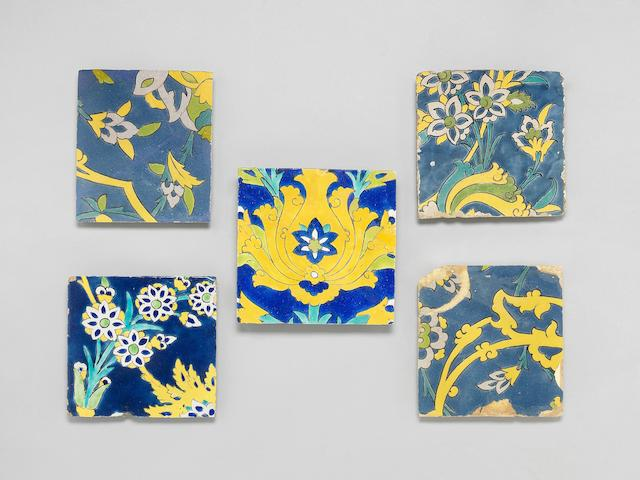 Four Safavid cuerda seca pottery Tiles