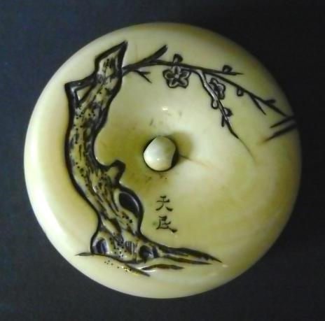An ivory manju netsuke