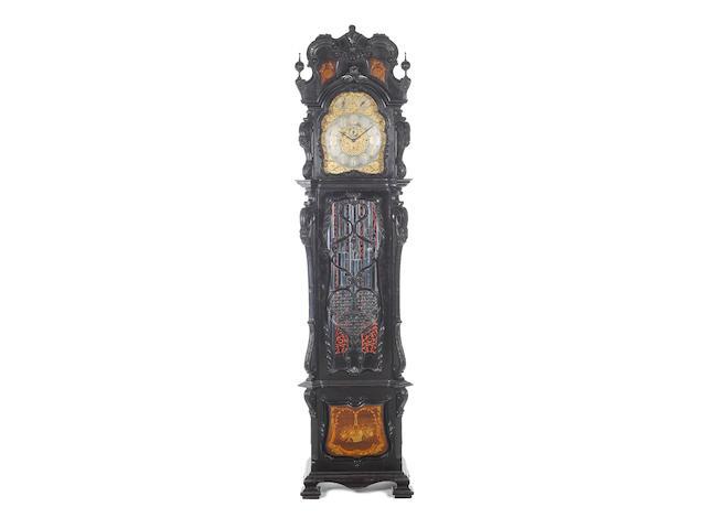 A most impressive early 20th Century carved ebonised tubular chiming longcase clock