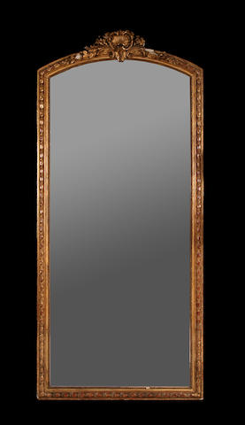 A large late 19th century North European giltwood and composition mirror