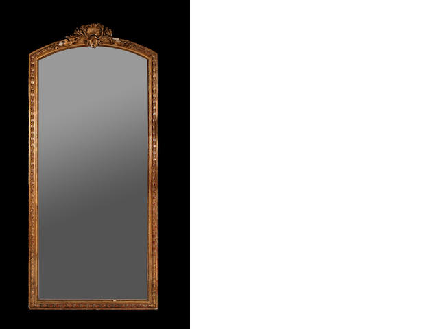 A large North European giltwood and composition mirror