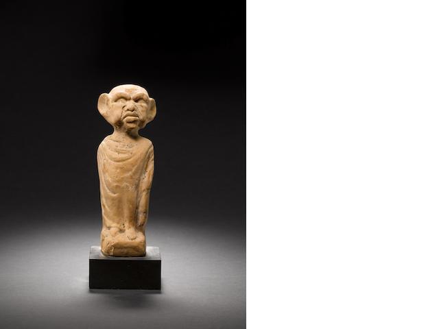 A Greek terracotta grotesque male figure