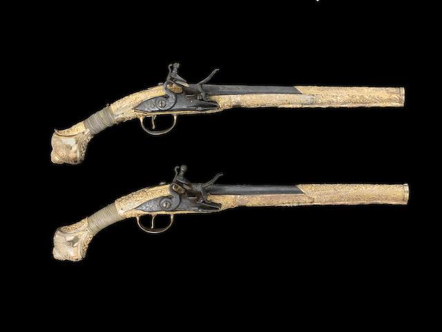 A pair of silver-gilt flintlock Pistols Provincial Ottoman, late 18th Century(2)