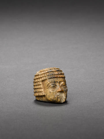An Egyptian miniature serpentine head