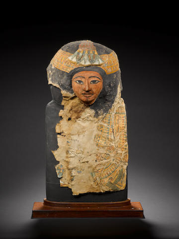 An Egyptian cartonnage female mummy mask