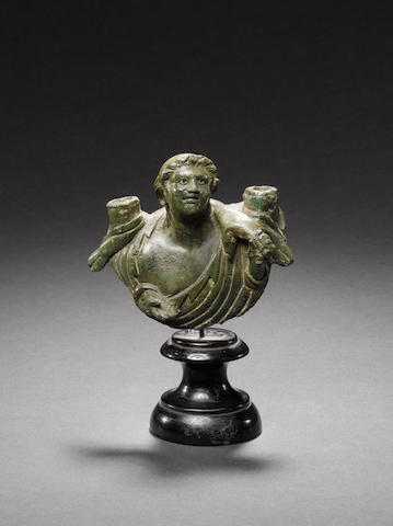 A Roman bronze attachment of a satyr