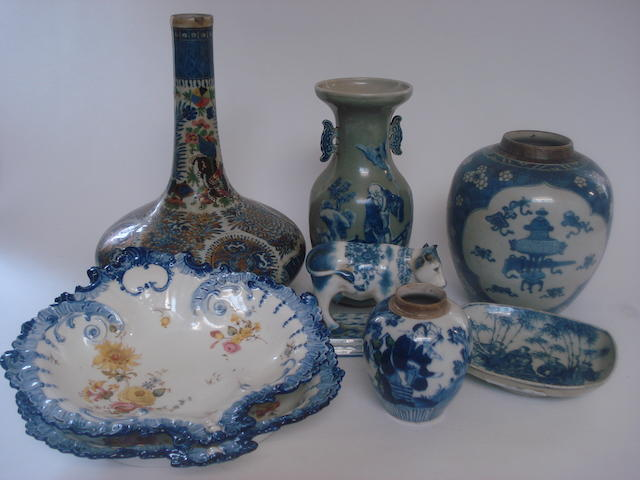 A collection of assorted blue and white ceramics