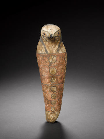 An Egyptian mummiform falcon