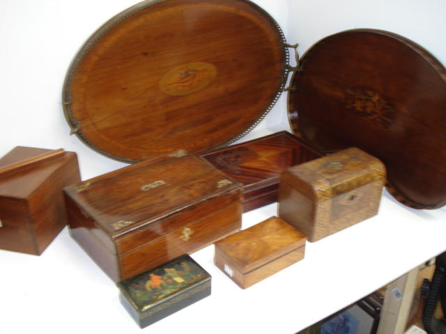 A 'Sheraton Revival' oval mahogany tray, with pierced brass gallery and side handles, satinwood crossbanded and inlaid with a conch shell, 68.5cm, a kidney shape similar, a Russian papier mache table snuff box, the hinged cover painted with a figural scene, Victorian walnut and parquetry tea caddy, late 19th Century French quarter veneered rosewood brass strung and decorated box, Victorian rosewood and mother of pearl inlaid box and two others. (8)