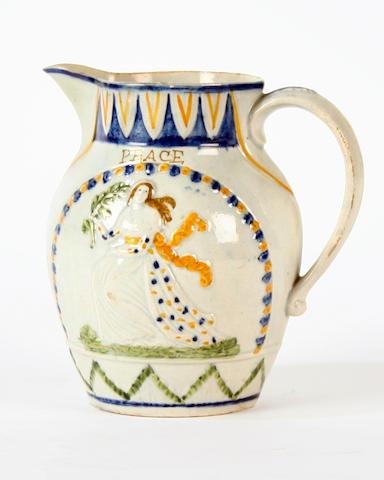 A prattware 'Peace and Plenty' jug, circa 1802