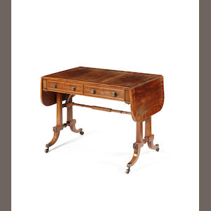 A Regency rosewood and satinwood cross-banded sofa table