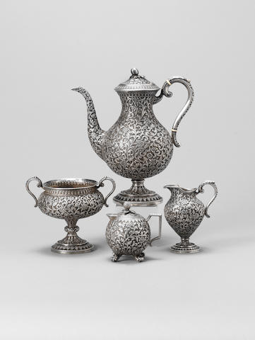 Three pieces from a fine Kutch silver Tea Set by Oomersi Mawji (O.M.) Bhuj, India, circa 1880(4)