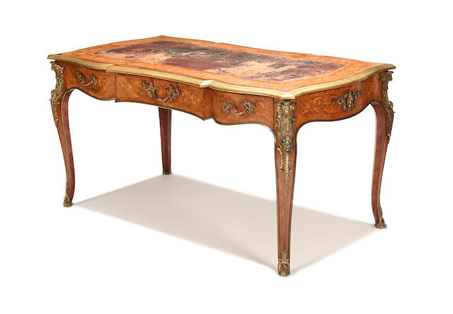 A Louis XV style gilt-brass mounted kingwood and marquetry bureau plat