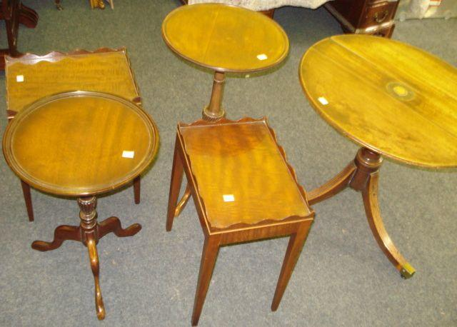 A pair of mahogany rectangular top lamp tables, with serpentine galleries, two tripod wine tables, and a George III mahogany base dumb waiter on three reeded sabre legs. (5)