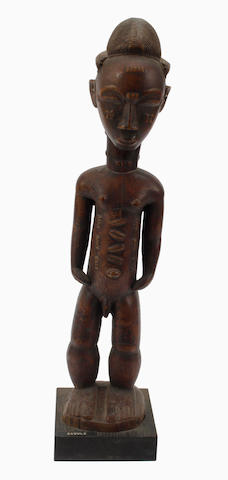 A Baule male figure Ivory Coast 44cm high