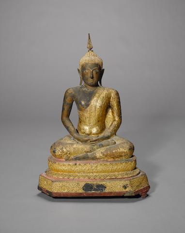 A South East Asian figure of a kneeling buddha 80cm high