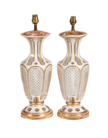 A pair of French overlay glass vases later adapted as lamp bases