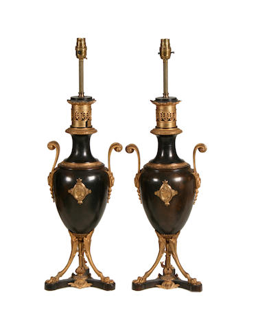 A pair of late 19th / early 20th century Greek Revival style gilt and patinated bronze urnslater adapted as lamp bases