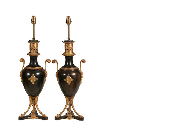 A pair of late 19th / early 20th century Greek Revival style gilt and patinated bronze urns later adapted as lamp bases