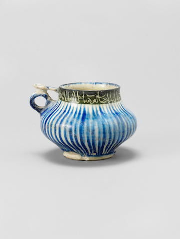 A Kashan underglaze-painted pottery Handled Cup Persia, circa 1200-20