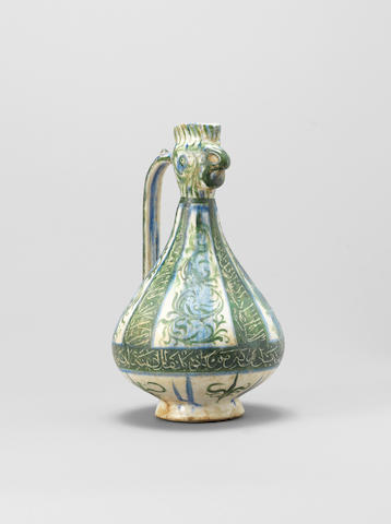 A Kashan underglaze-painted pottery Cocks Head Ewer Persia, circa 1200-20