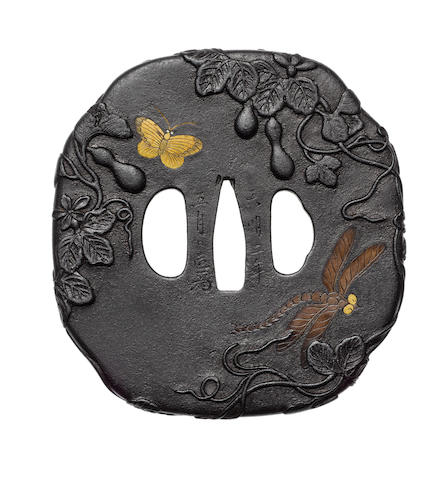 A large iron tsuba Ichinomiya School, dated 1782