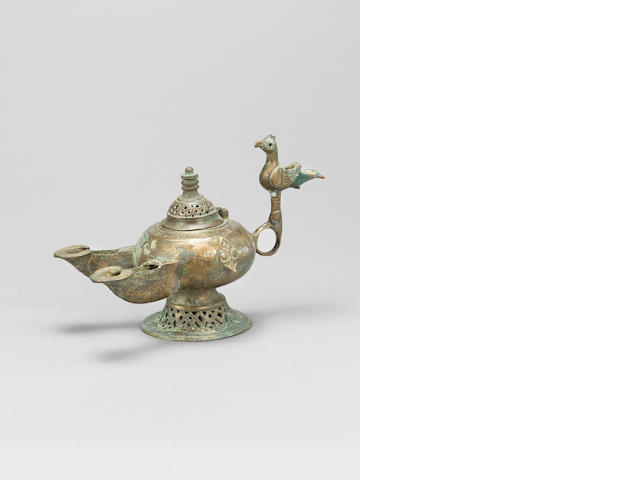 A Khorasan brass incense burner with double spout