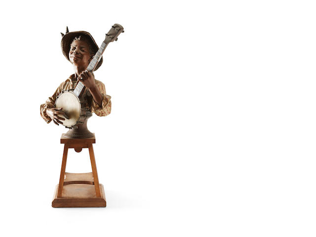 A early 20th century spelter figure of musician