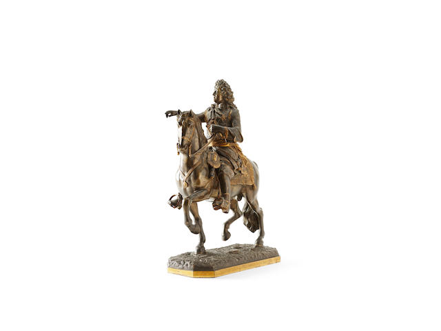 A 19th Century bronze equestrian figure group of Louis XIV