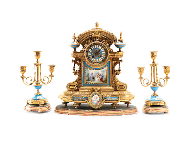 A 19th century French Serve style ormolu and porcelain clock graniture