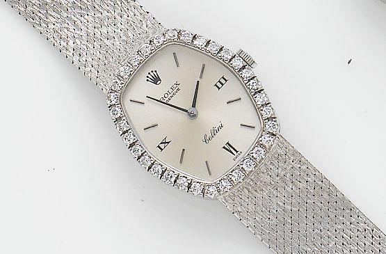 Rolex. A lady's 18ct white gold manual wind diamond set bracelet watch Cellini, Circa 1980