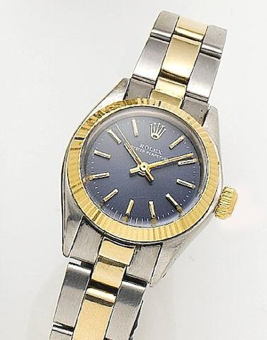 Rolex. A lady's stainless steel and gold bracelet watch Ref 6718, Serial number 6277798, Circa 1980