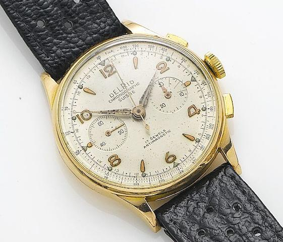 Swiss. An 18ct gold manual wind chronograph wristwatch