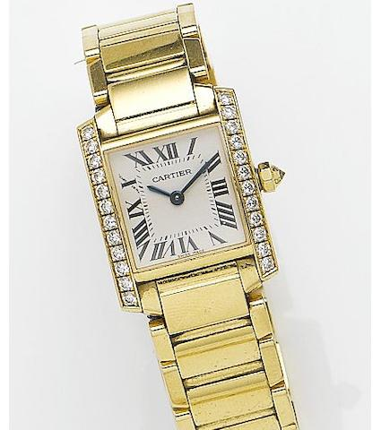 Cartier. A lady's 18ct gold and diamond set quartz bracelet watch together with a fitted box and papers Tank Francaise, Reference 2385, Case Number 883391CD, Sold 16th April 2005