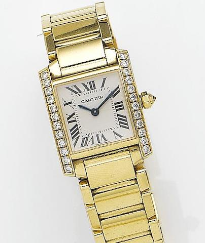 Cartier. A lady's 18ct gold and diamond set quartz bracelet watch together with a fitted box and papersTank Francaise, Reference 2385, Case Number 883391CD, Sold 16th April 2005