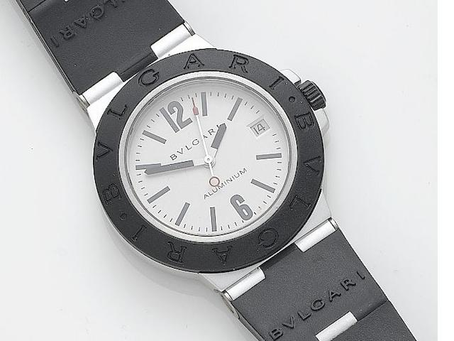 Bulgari. A titanium and rubber centre seconds calendar wristwatch Ref: 100704, Case: M62552, Recent