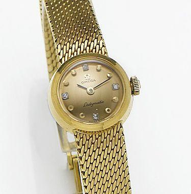 Omega. A lady's 18ct gold automatic bracelet watch together with fitted box and papersConstellation, Sold 3rd of May 1967