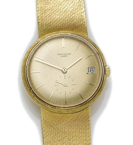 Patek Phillipe. An 18ct gold automatic calendar bracelet watch Ref:3445, Movement No. 1129265, 1960's