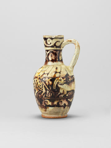 A Garrus carved pottery Jar Persia, 12th/ 13th Century