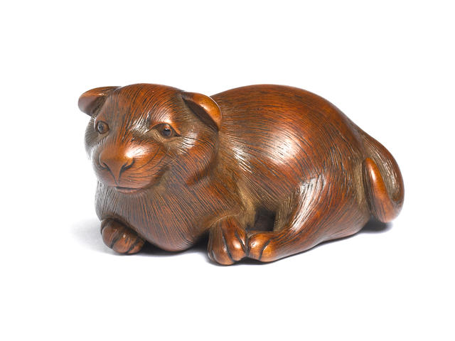 A wood netsuke of a dog By Masanao, Kyoto, late 18th century