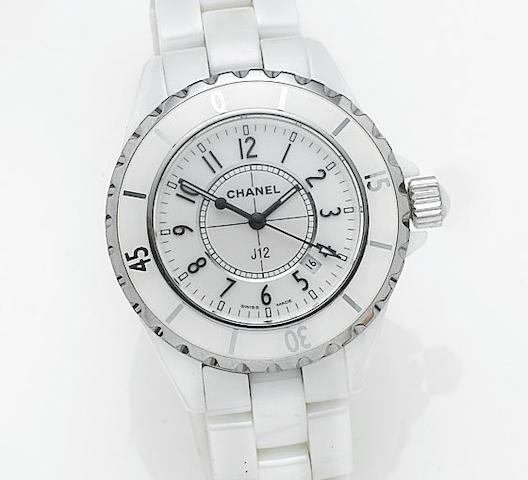 Chanel. A lady's mid-sized white ceramic quartz calendar bracelet watch together with spare links, presentation box and papersRef: HO968, Serial No. DH81901, Sold in Chanel, New Bond Street, 4th March 2005