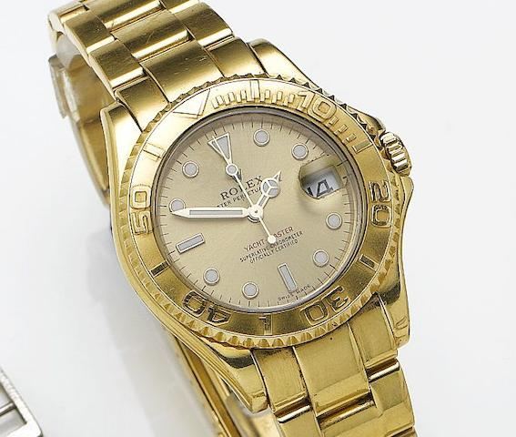 Rolex. An 18ct gold automatic bracelet watch with dateYacht-Master, Reference 168628, Case Number A712950, Circa 1998