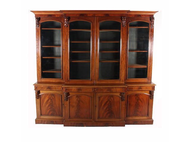 A mid-Victorian figured mahogany breakfront library bookcase