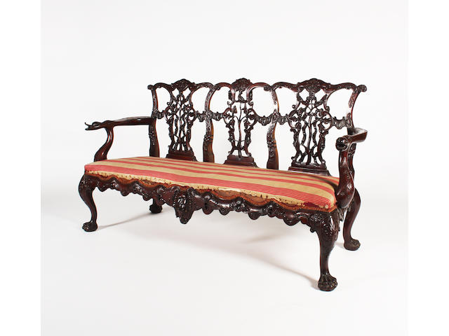 A good and elaborate pair of mid-18th century style carved mahogany settees, circa 1880, probably Irish