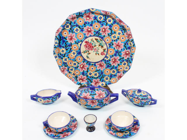 A French pottery 'cloisonne' style breakfast set