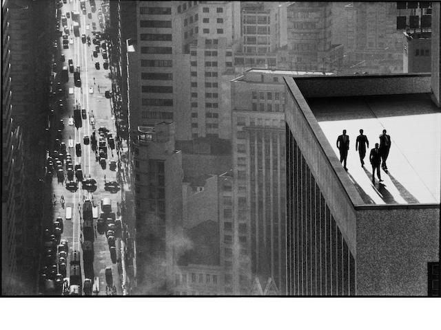 René Burri (Swiss, born 1933) Men on a Rooftop: S&atildeo Paulo, Brazil, 1960 Paper 40 x 49.9cm (50 3/4 x 19 5/8in), image 28 x 41.8cm (11 x 16 5/8in)