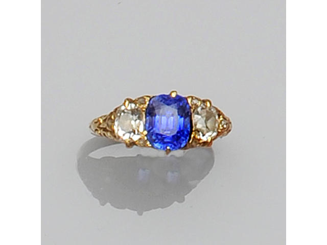 A sapphire and diamond three stone ring