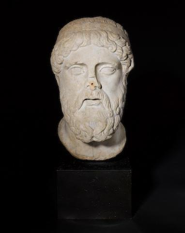 A Roman marble head of a god