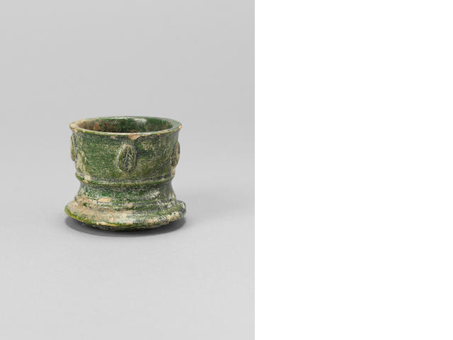 An Umayyad green monochrome pottery vase